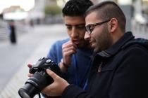 UNDPI Media trainees, Shadi & Musaab, discuss technique.